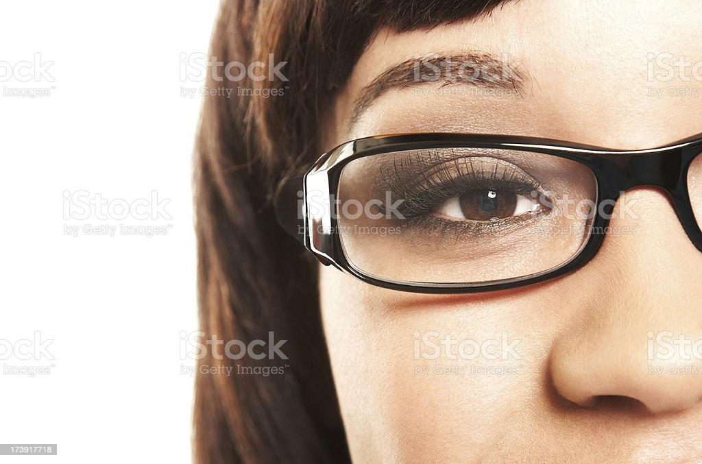 Close-up of a woman with black eyeglasses. Isolated. royalty-free stock photo