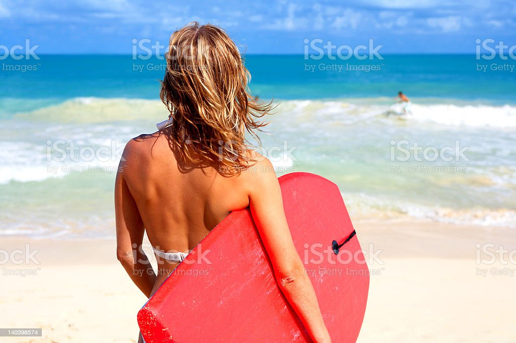 Close-up of a woman with surfboard royalty-free stock photo