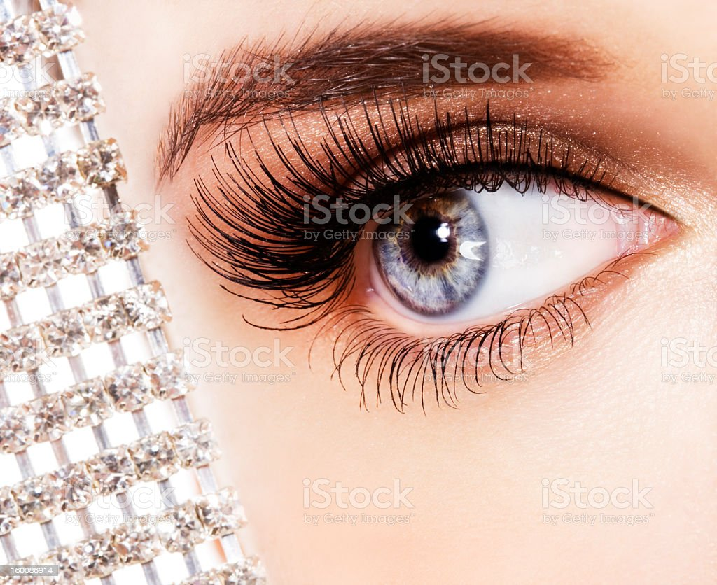 A close-up of a woman's beautiful blue eye and long lashes royalty-free stock photo