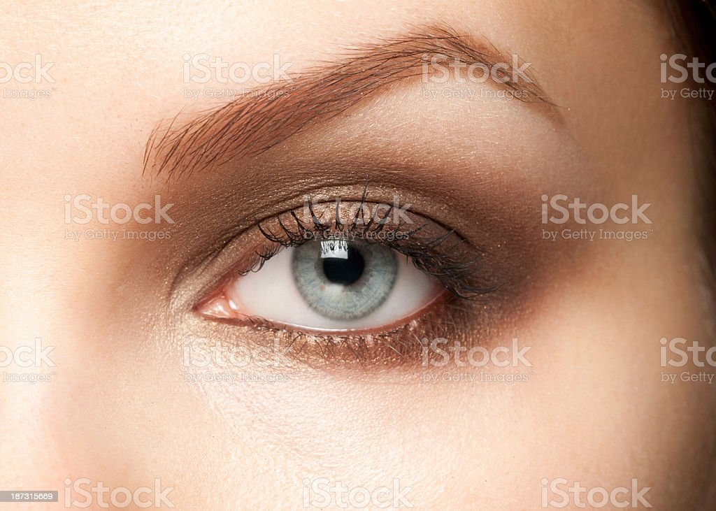 Close-up of a woman's blue eye with cosmetics applied stock photo