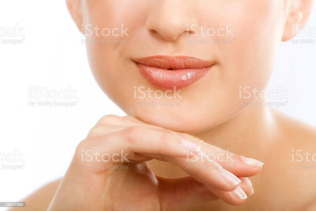 Close-up of a woman's face and nails royalty-free stock photo
