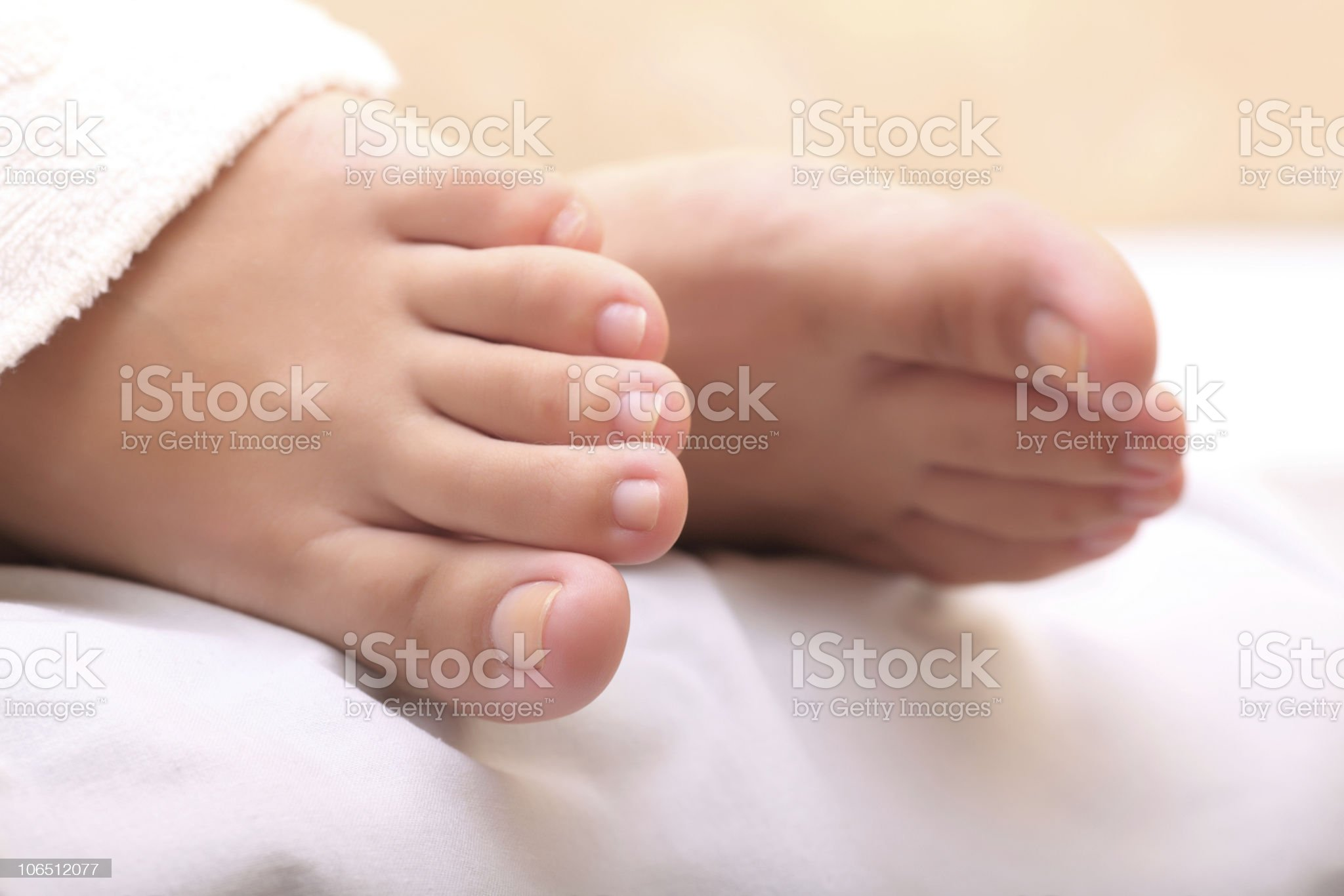 Close-up of a woman's feet on white linen royalty-free stock photo