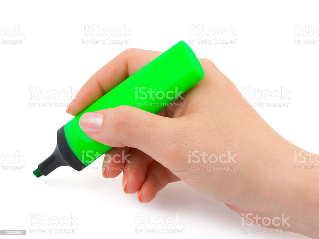 Close-up of a woman's hand holding a green highlighter royalty-free stock photo