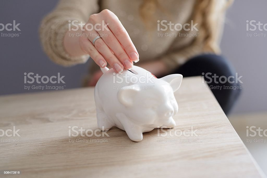 Closeup of a woman's hand inserting a coin stock photo