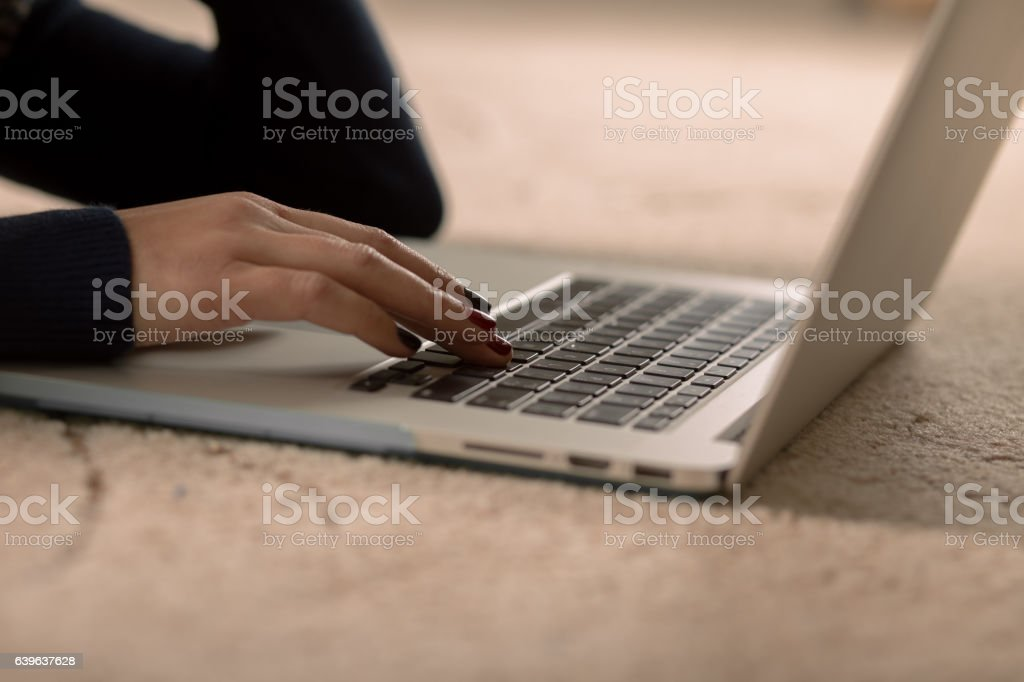 Closeup of a woman's hand working on laptop stock photo