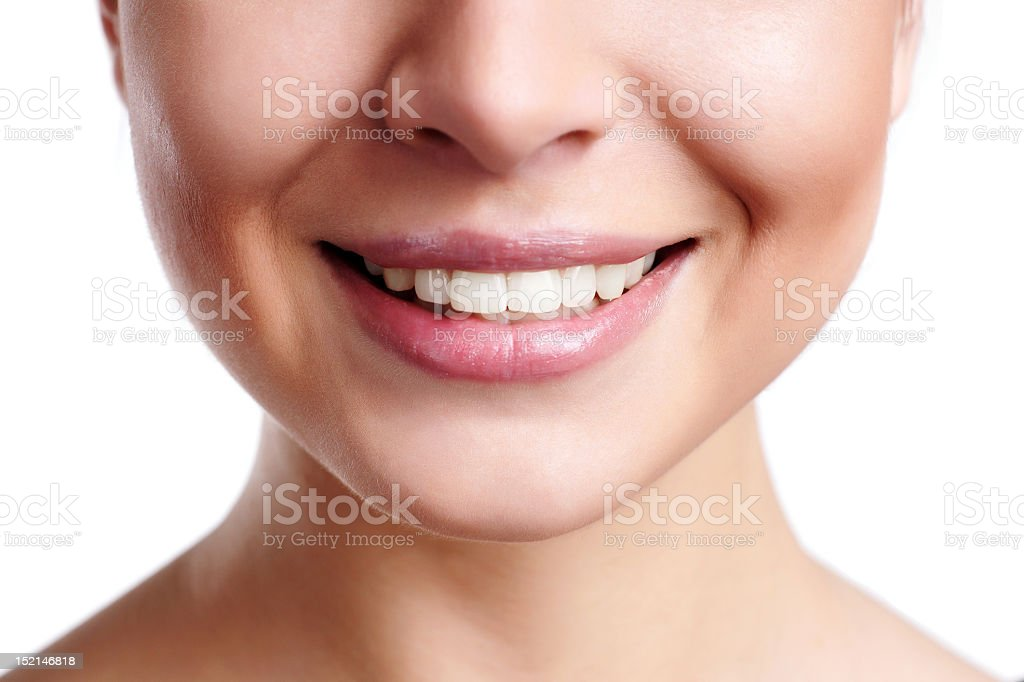 Close-up of a woman's pink lips and smile royalty-free stock photo