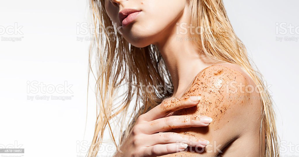 Close-up of a woman's shoulder with scrub of coffee stock photo