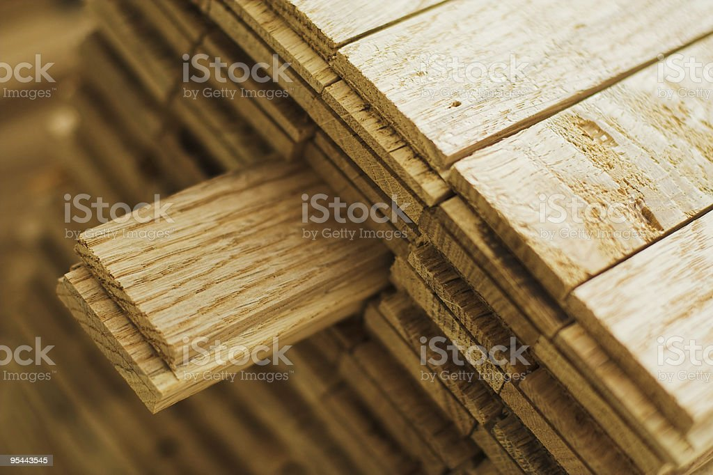 Close-up of a wood parquet piece sticking out of the pile royalty-free stock photo