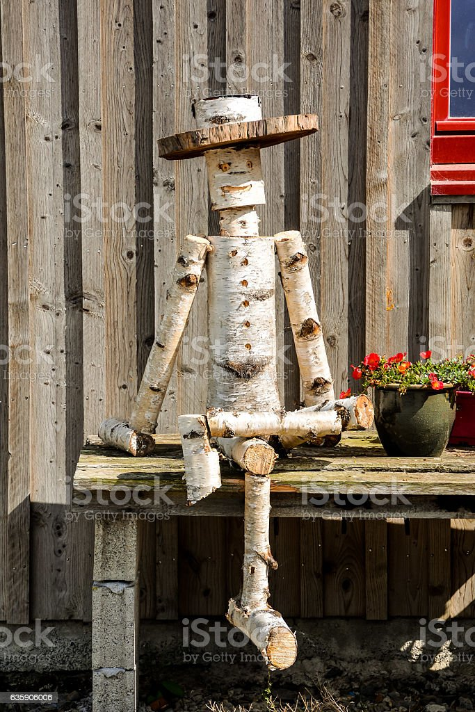 Closeup of a Wooden Puppet made by Tree Trunk stock photo