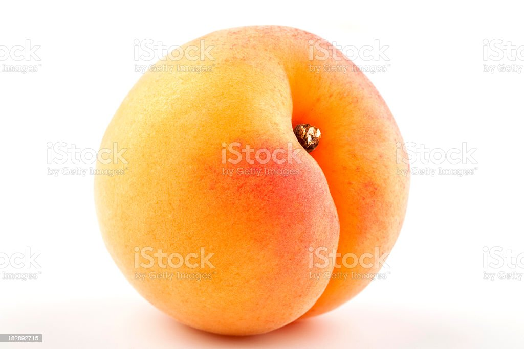 Close-up of a yellow-red apricot isolated on white stock photo