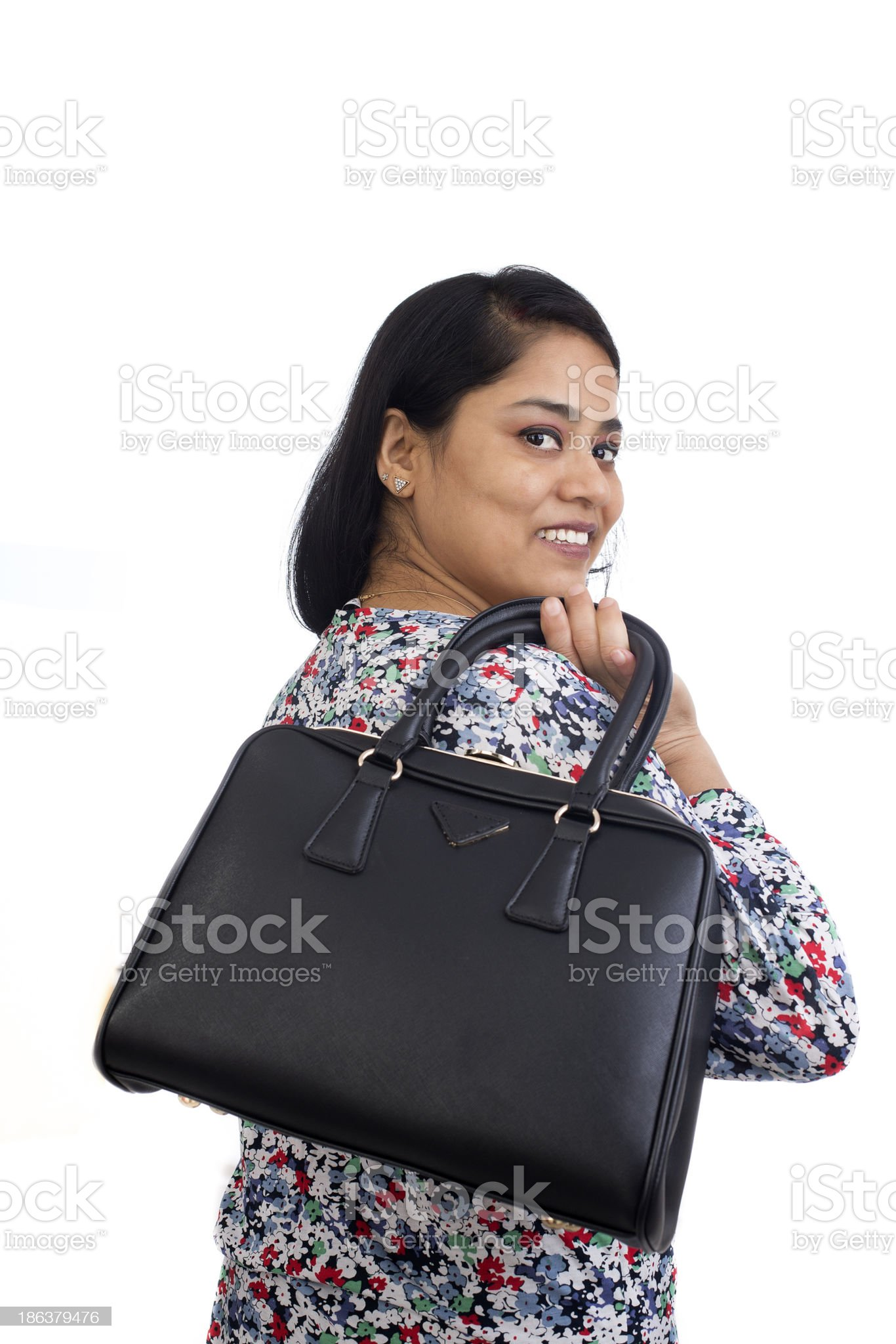 Closeup of a young Asian Indian woman carrying her handbag. royalty-free stock photo