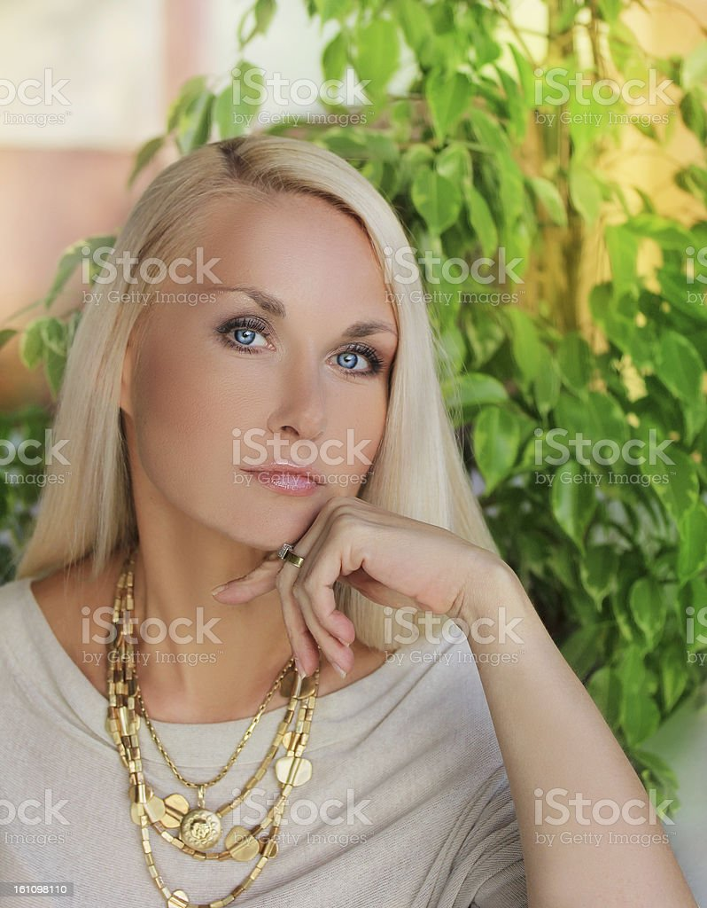 Close-up of a young, beautiful, blue-eyed caucasian woman royalty-free stock photo