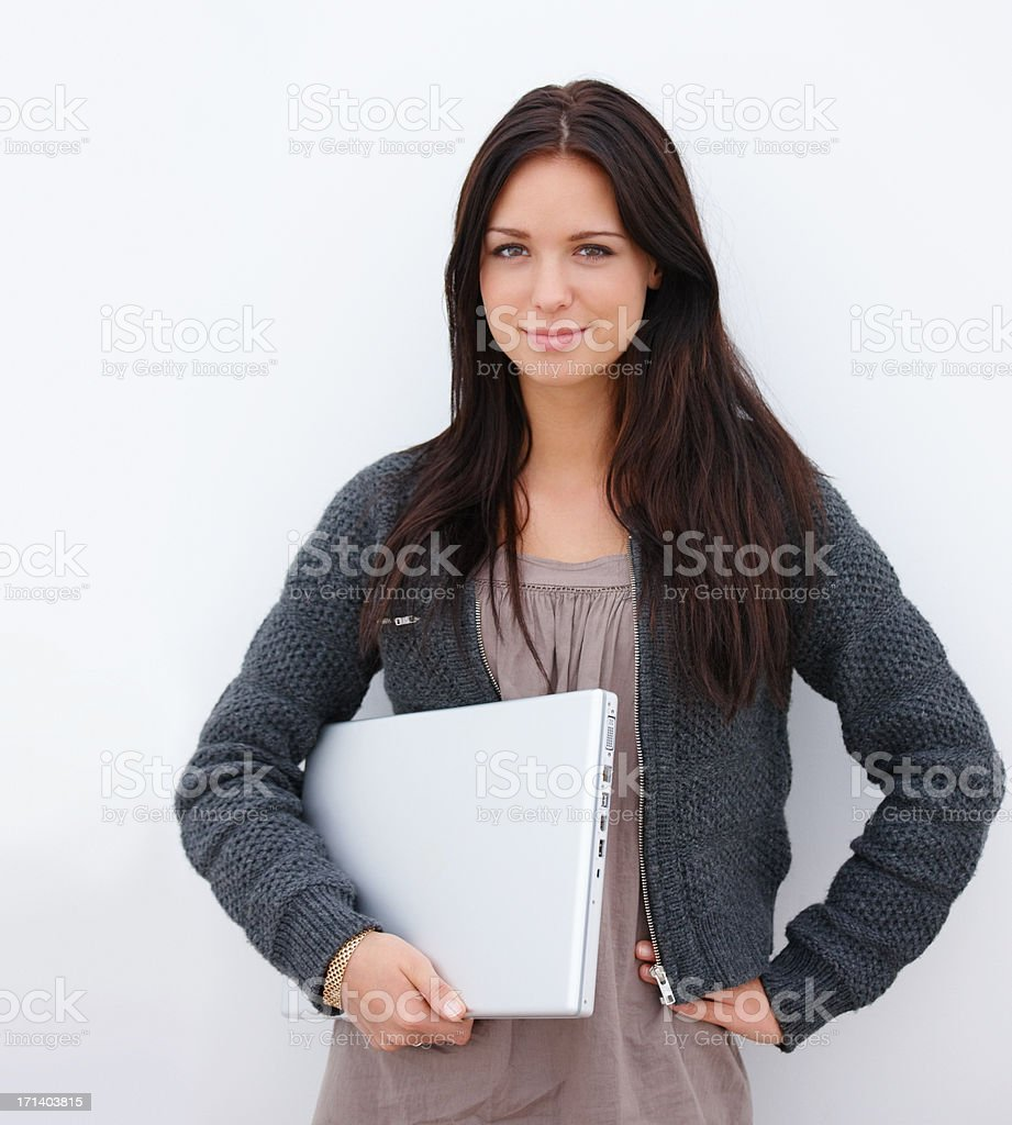 Closeup of a young beautiful woman standing with a laptop isolated on white background royalty-free stock photo