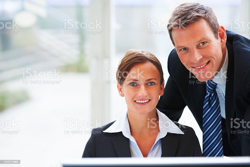 Close-up of a young business colleagues smiling royalty-free stock photo