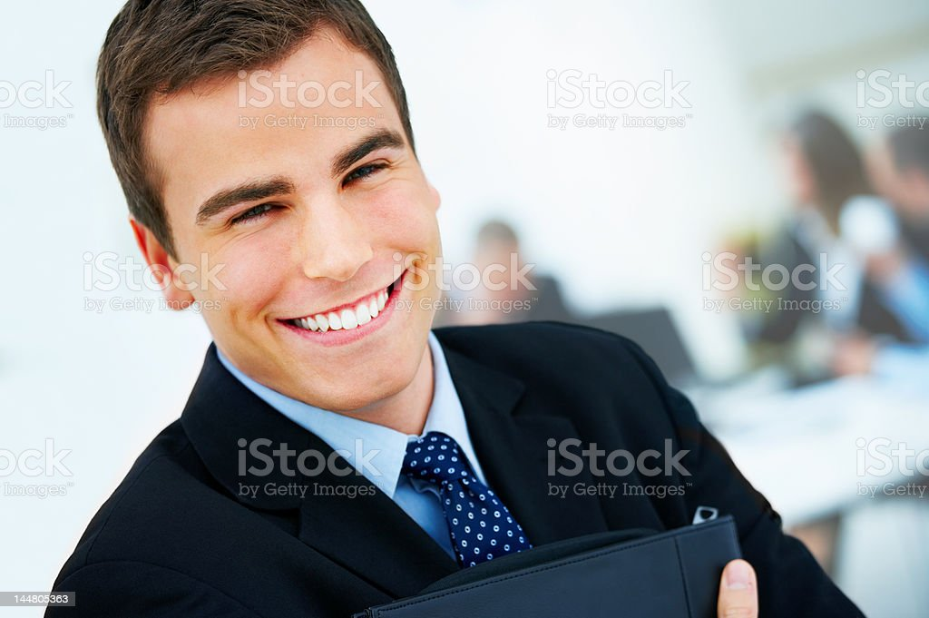 Close-up of a young businessman smiling royalty-free stock photo