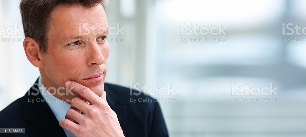 Close-up of a young businessman thinking royalty-free stock photo