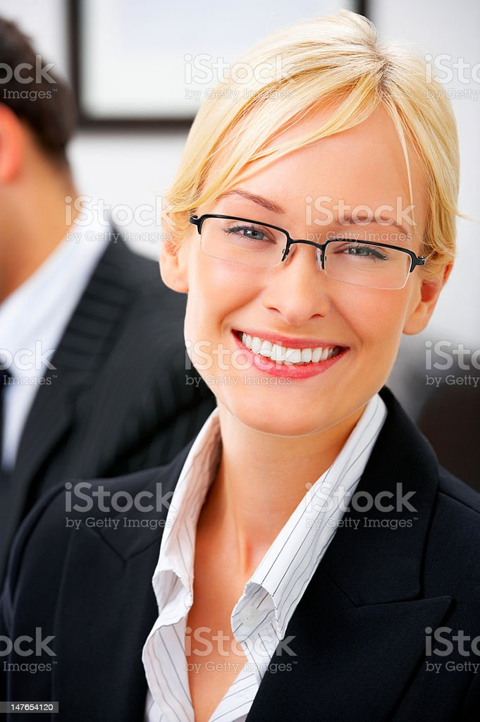 Close-up of a young businesswoman smiling in office royalty-free stock photo