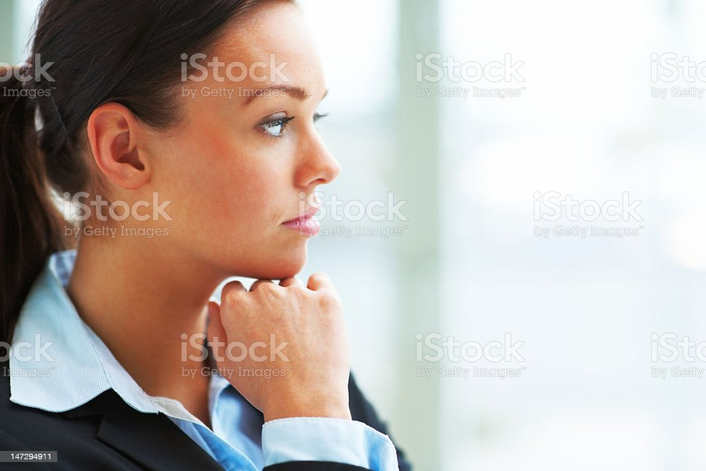 Close-up of a young businesswoman thinking stock photo