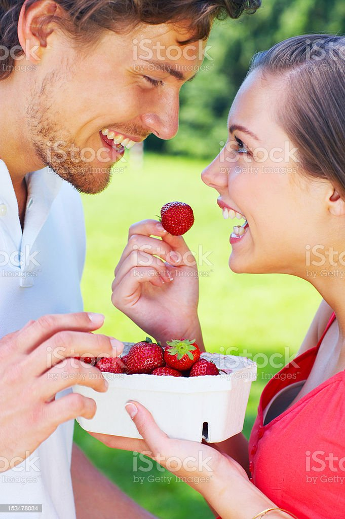 Close-up of a young couple eating strawberries royalty-free stock photo