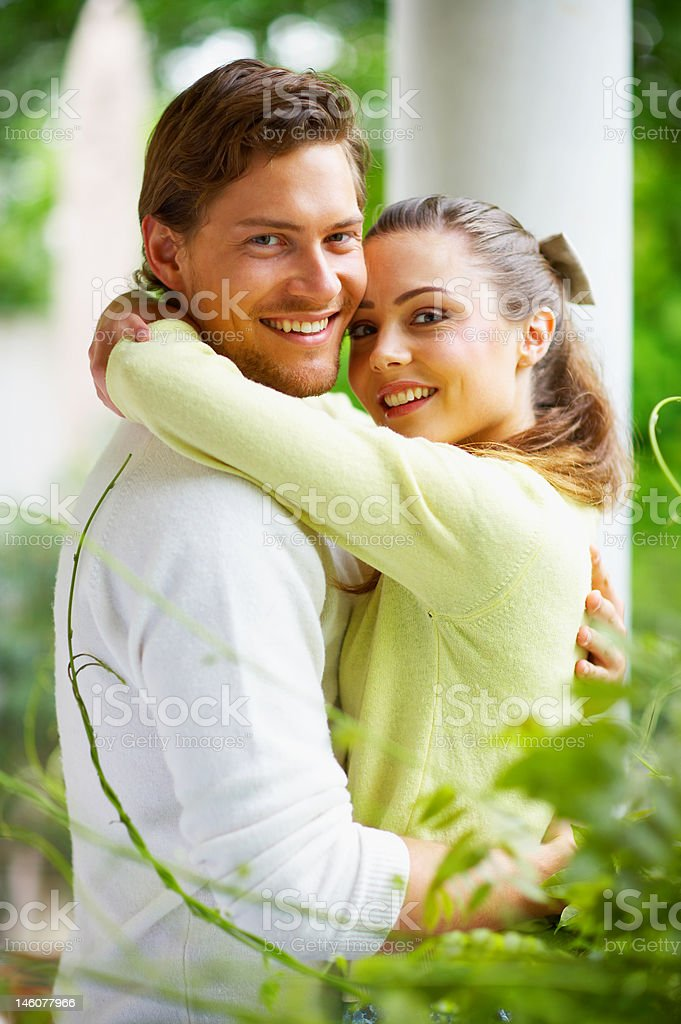 Close-up of a young couple embracing on french balcony royalty-free stock photo