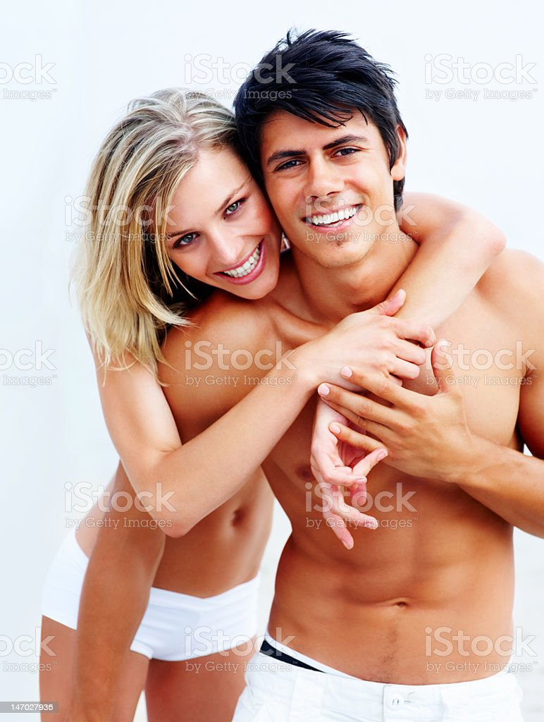 Close-up of a young couple enjoying on the beach royalty-free stock photo