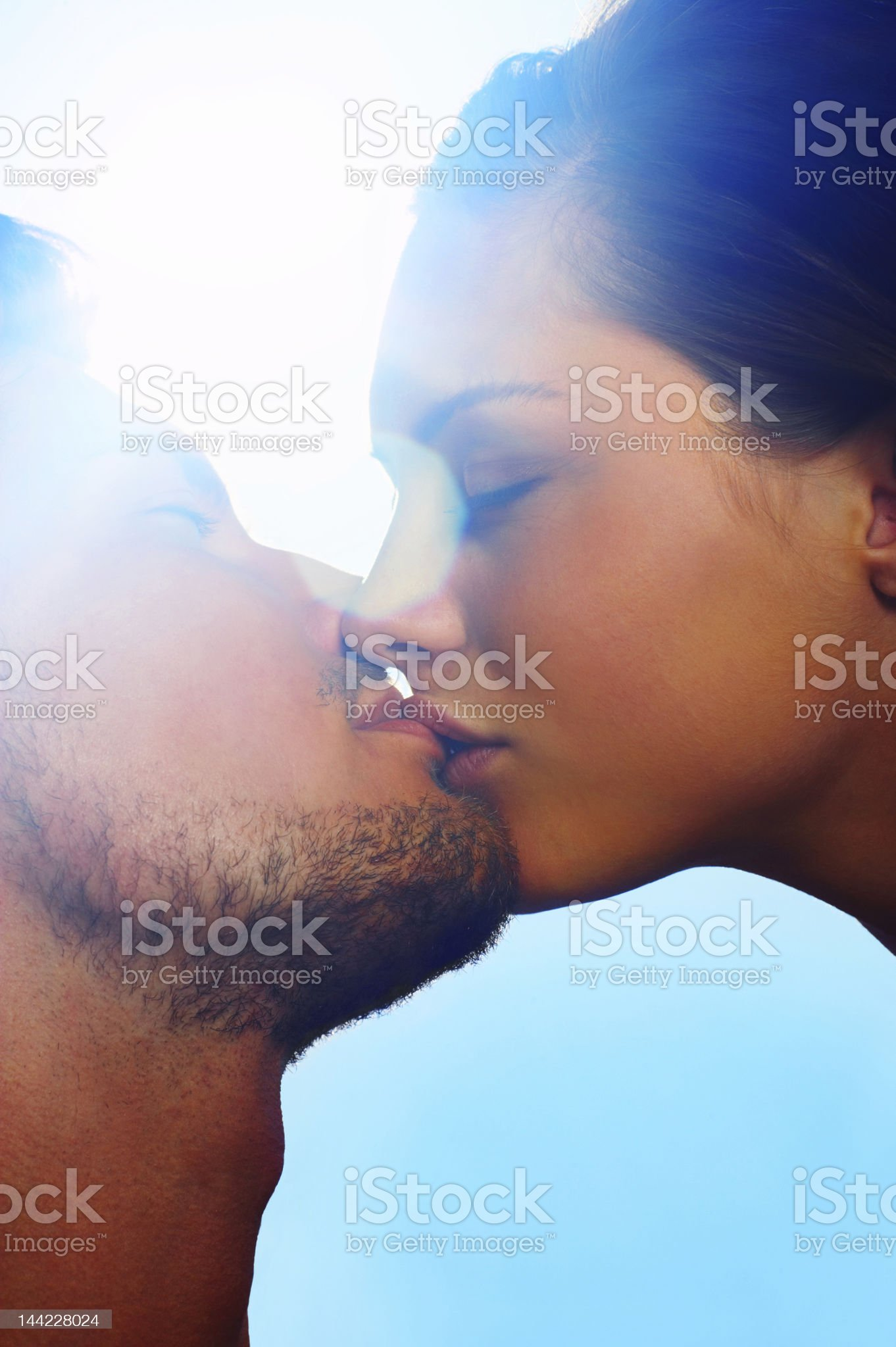 Close-up of a young couple kissing each other royalty-free stock photo