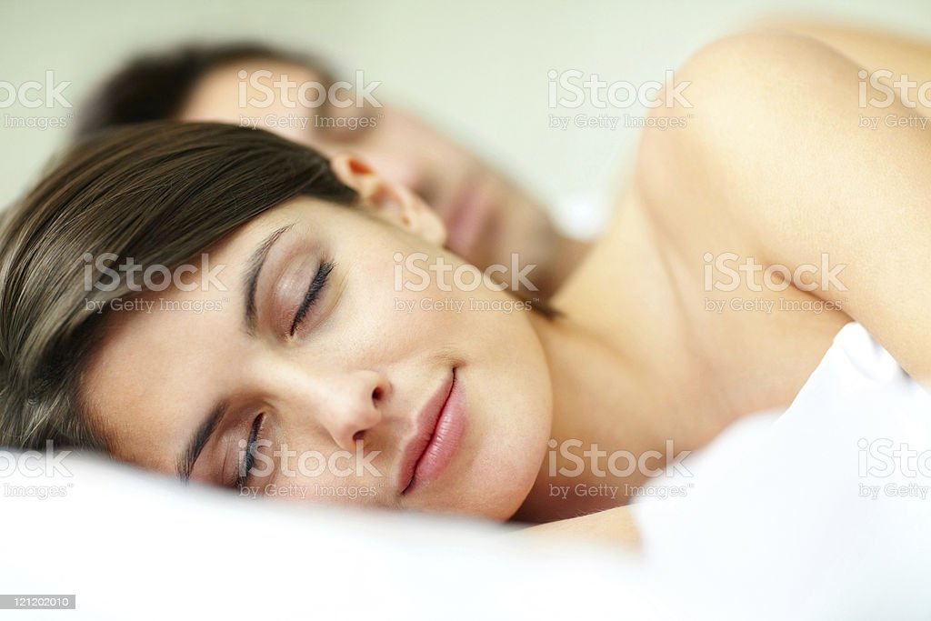 Close-up of a young couple sleeping royalty-free stock photo