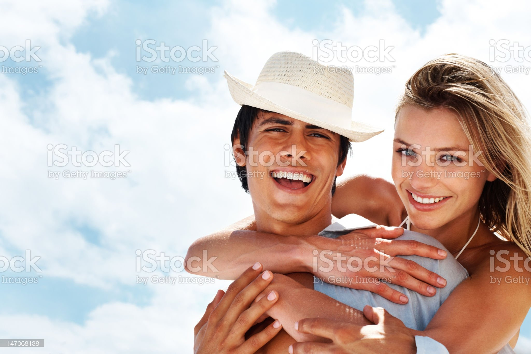 Close-up of a young couple smiling and embracing royalty-free stock photo