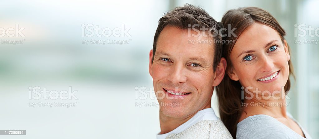 Close-up of a young couple smiling royalty-free stock photo