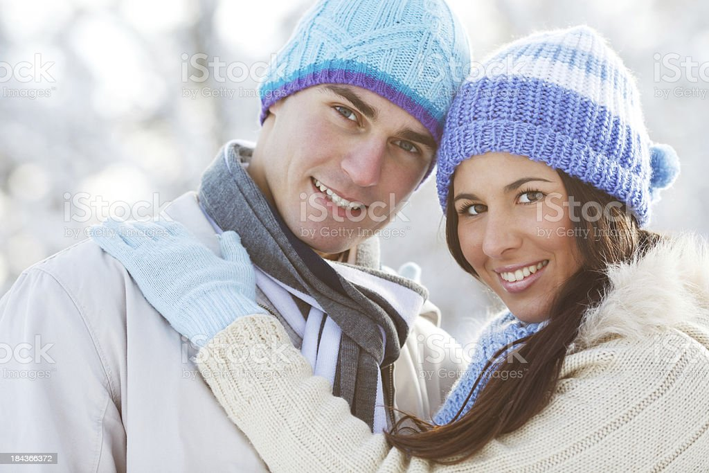 Close-up of a young couple wearing knit hats. royalty-free stock photo