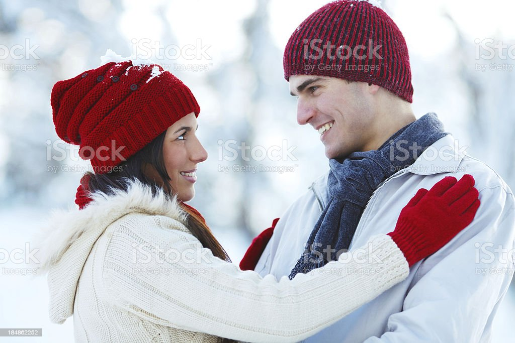 Close-up of a young couple wearing knit hats. stock photo
