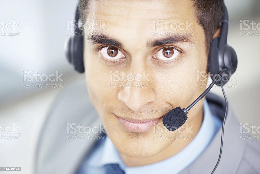 Closeup of a young customer care representative royalty-free stock photo