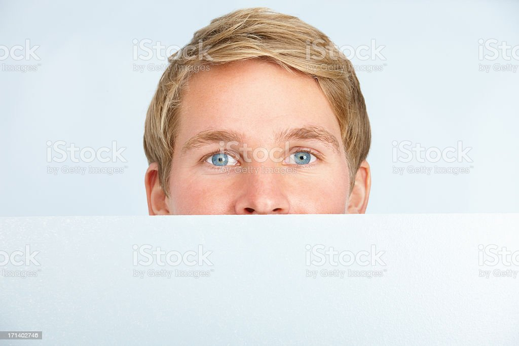 Closeup of a young man holding a billboard isolated  stock photo
