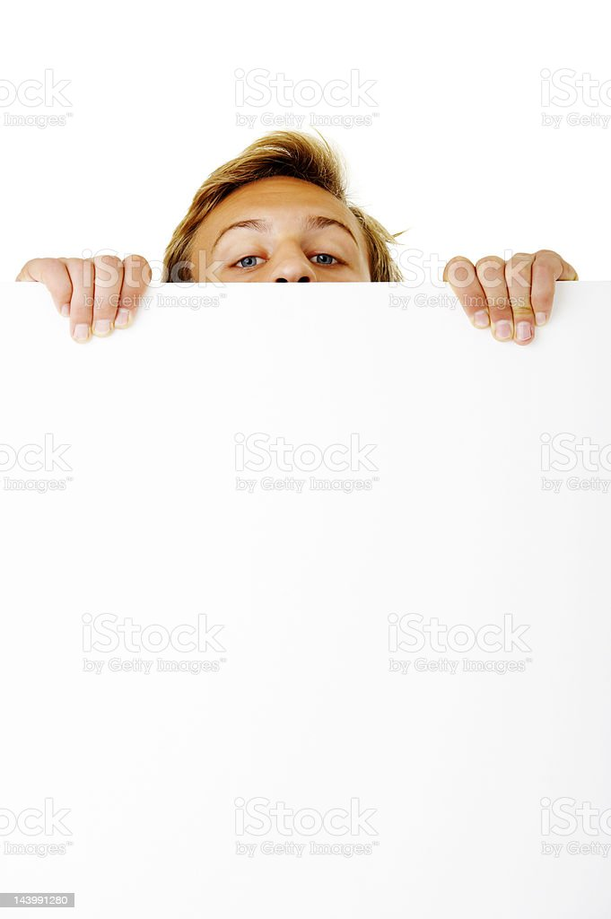 Close-up of a young man looking over white board stock photo