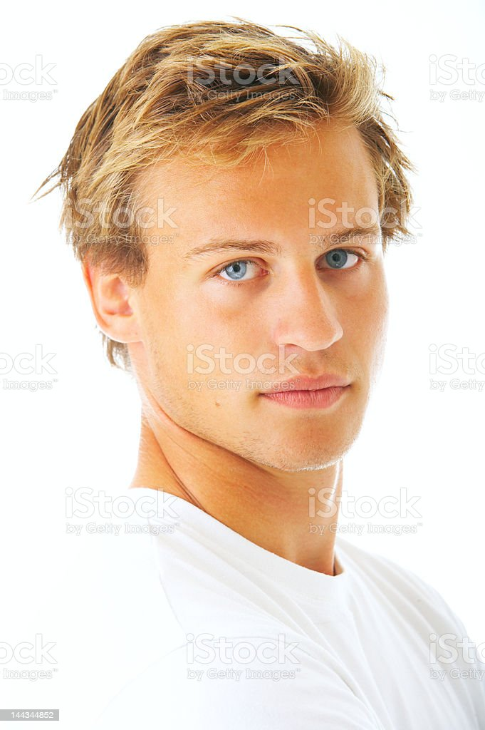 Close-up of a young man looking serious royalty-free stock photo