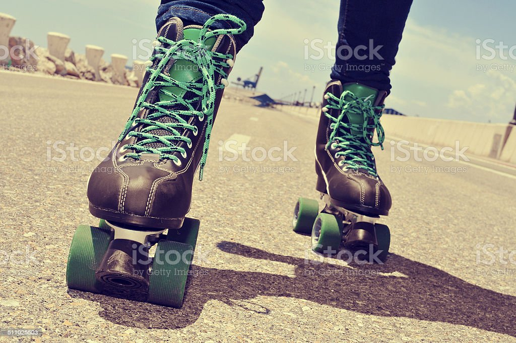 closeup of a young man roller skating stock photo