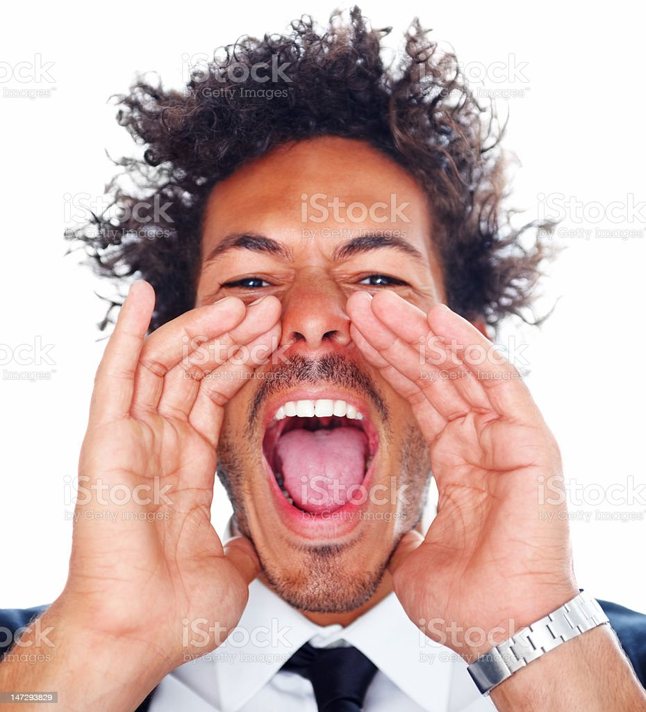 Close-up of a young man screaming against white background royalty-free stock photo