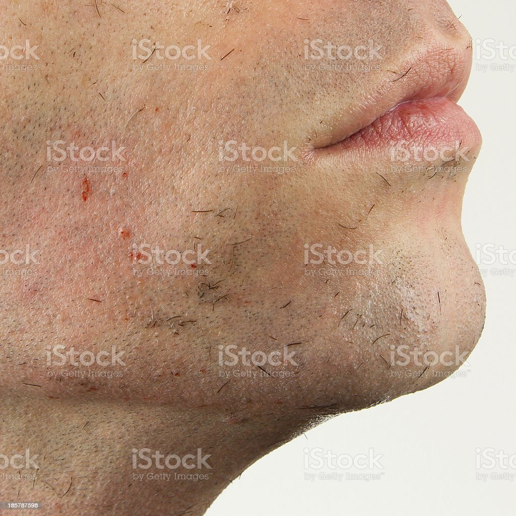 Close-up of a young man shaving royalty-free stock photo