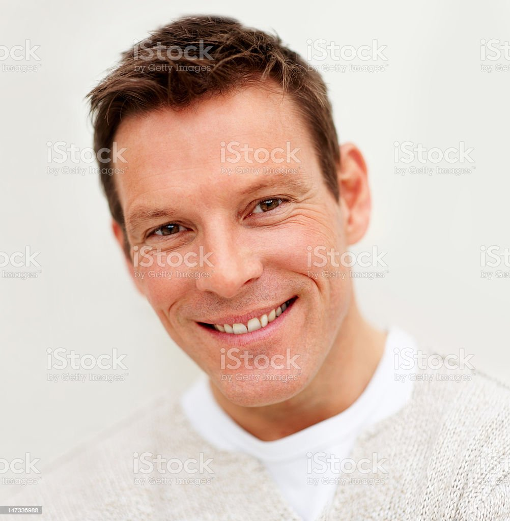 Close-up of a young man smiling royalty-free stock photo