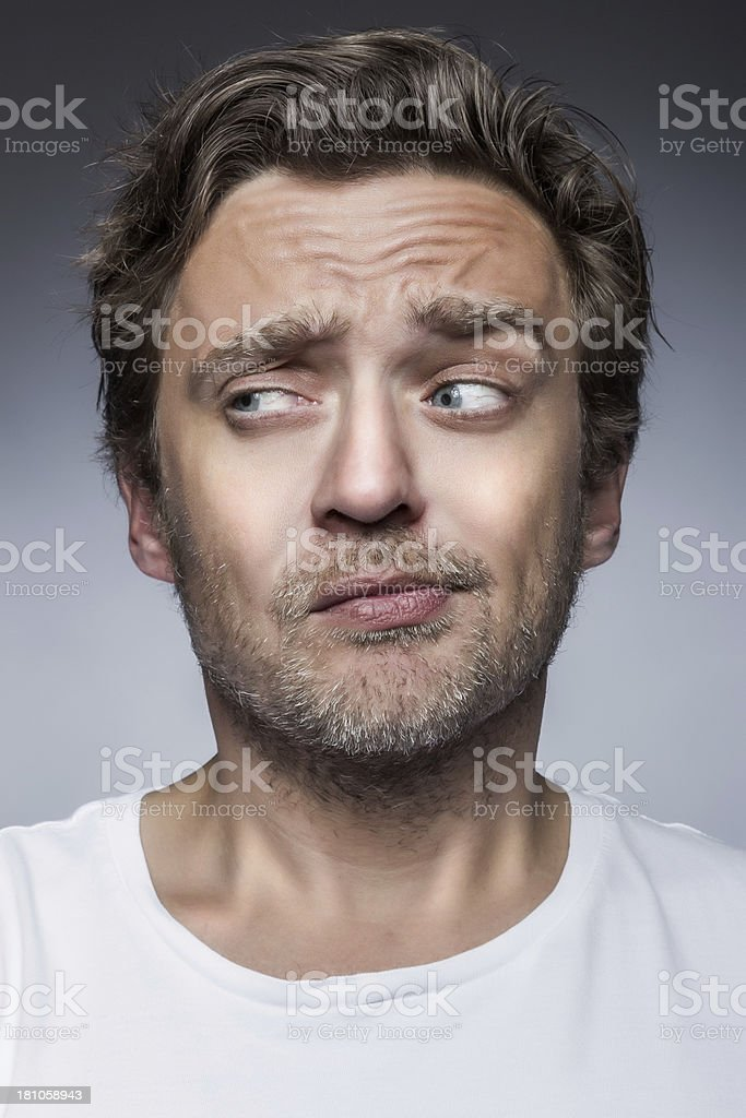 Close-up of a young man smirking royalty-free stock photo
