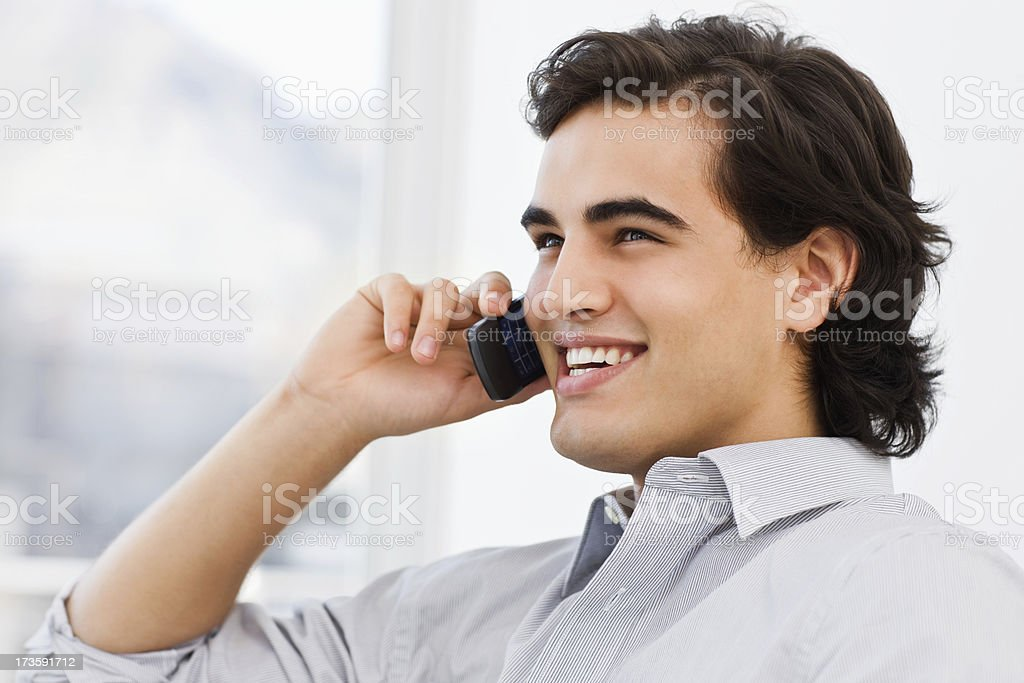Closeup of a young man talking on mobile phone royalty-free stock photo