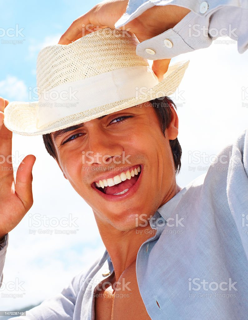 Close-up of a young man wearing hat and laughing royalty-free stock photo