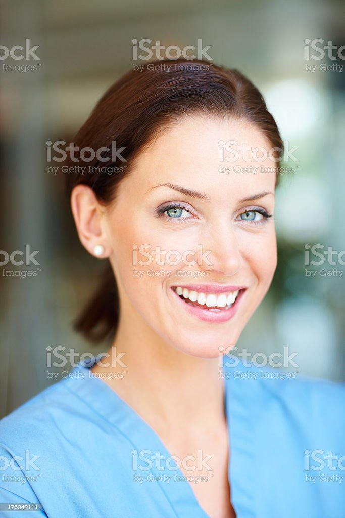 Closeup of a young  nurse smiling royalty-free stock photo