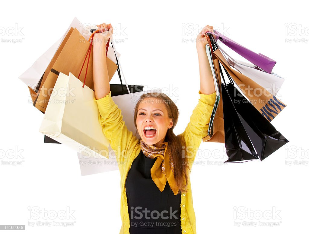 Close-up of a young woman cheering with shopping bags royalty-free stock photo