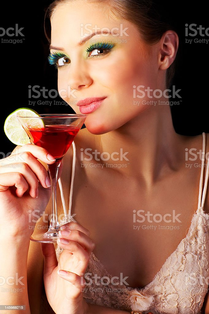 Close-up of a young woman drinking cocktail royalty-free stock photo