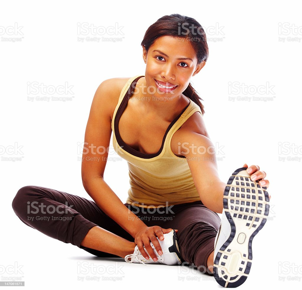 Close-up of a young woman exercising against white background royalty-free stock photo