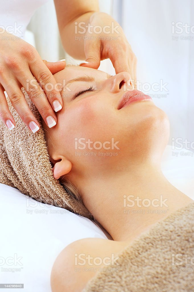 Close-up of a young woman getting spa treatment royalty-free stock photo