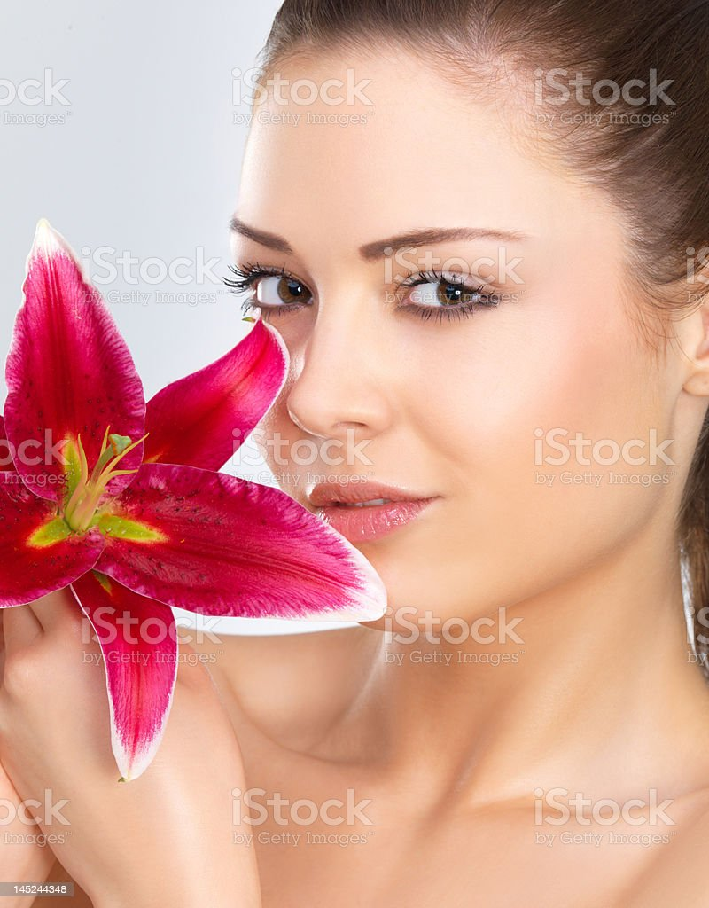 Close-up of a young woman holding flower royalty-free stock photo