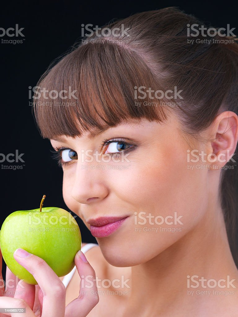 Close-up of a young woman holding green apple royalty-free stock photo