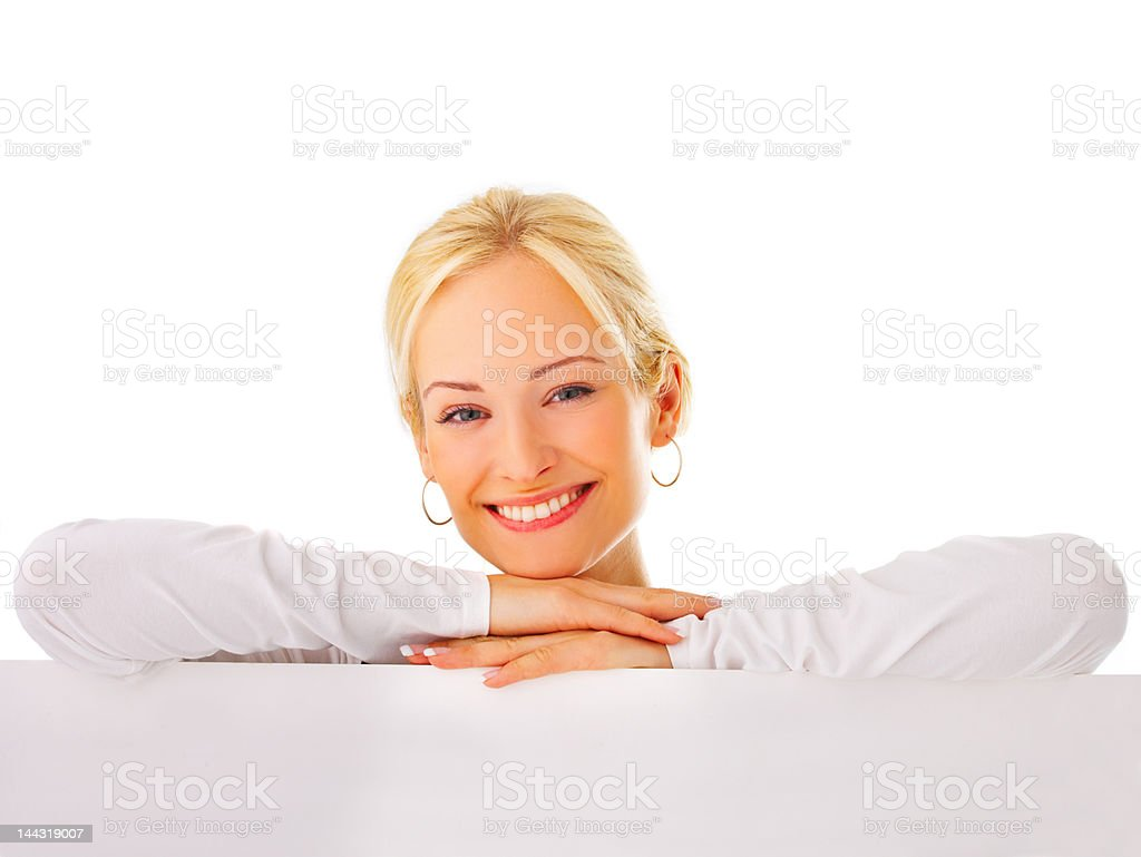 Close-up of a young woman leaning on billboard royalty-free stock photo